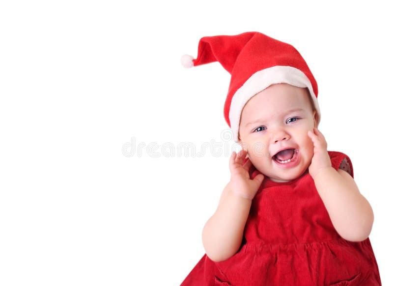 圣诞老人帽子的婴孩在白色 免版税库存照片