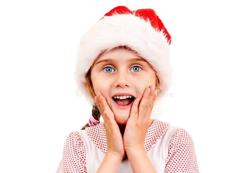 圣诞老人帽子的小女孩 库存照片