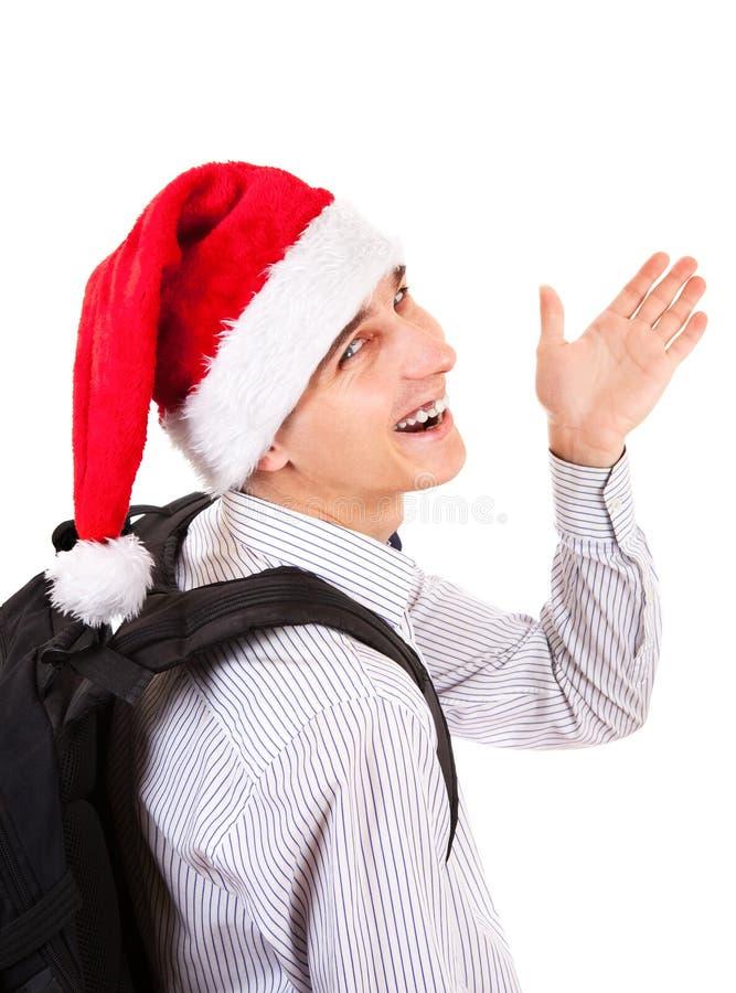 圣诞老人帽子的少年 图库摄影