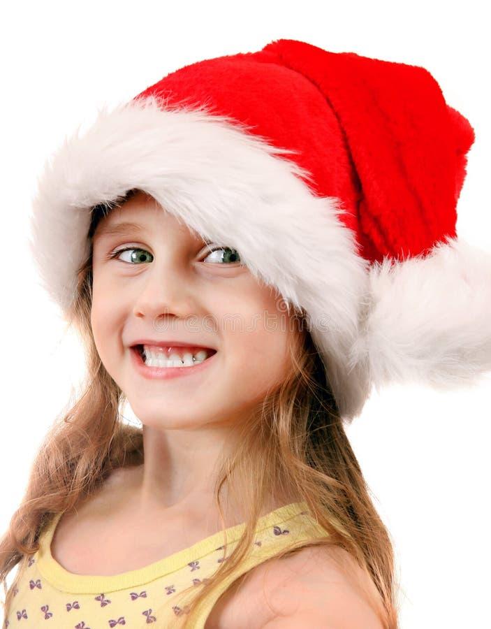 圣诞老人帽子的快乐的女孩 库存图片
