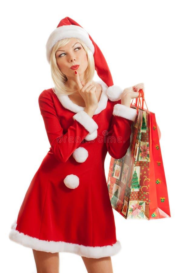 圣诞老人帽子的性感的妇女 库存照片