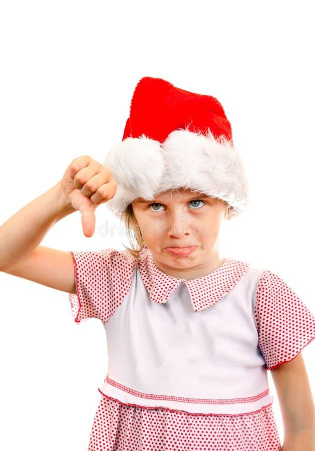 圣诞老人帽子的懊恼小女孩 库存图片