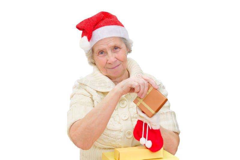 戴圣诞老人帽子的祖母 库存照片