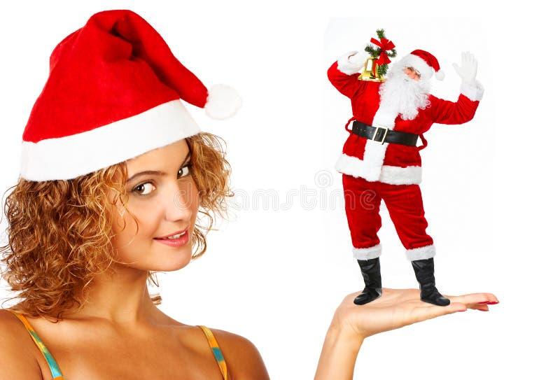 圣诞老人微笑的妇女 库存照片