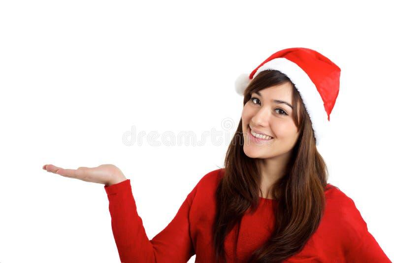 圣诞老人拿着产品的圣诞节妇女 免版税库存照片