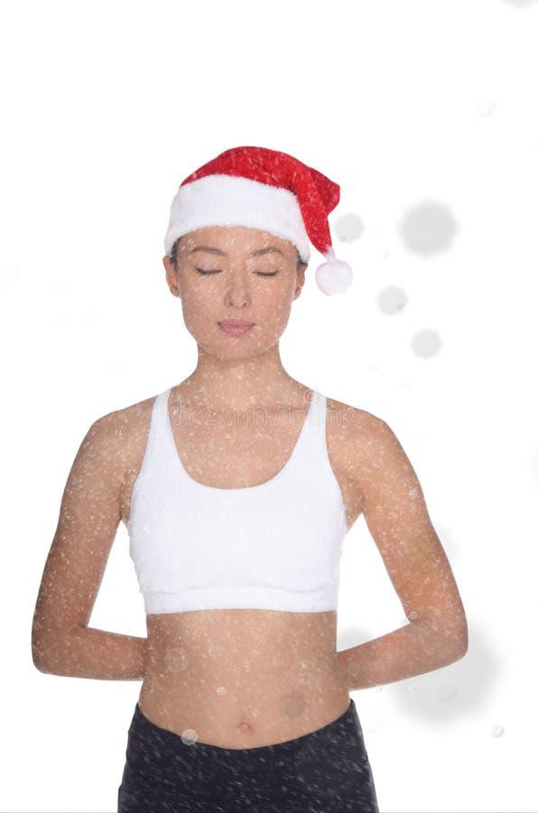 圣诞老人服装的亚裔妇女参与健身 图库摄影