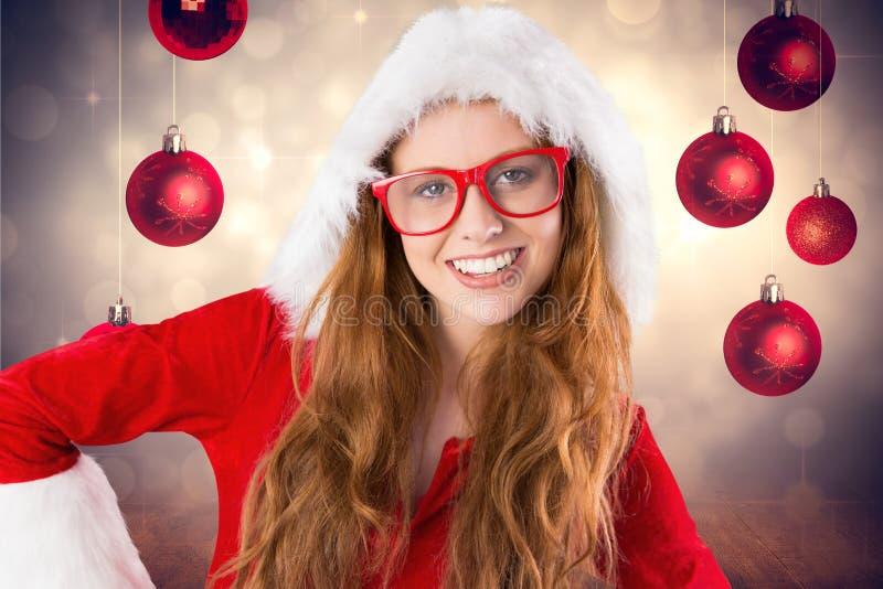 圣诞老人服装的妇女微笑对照相机的 库存照片