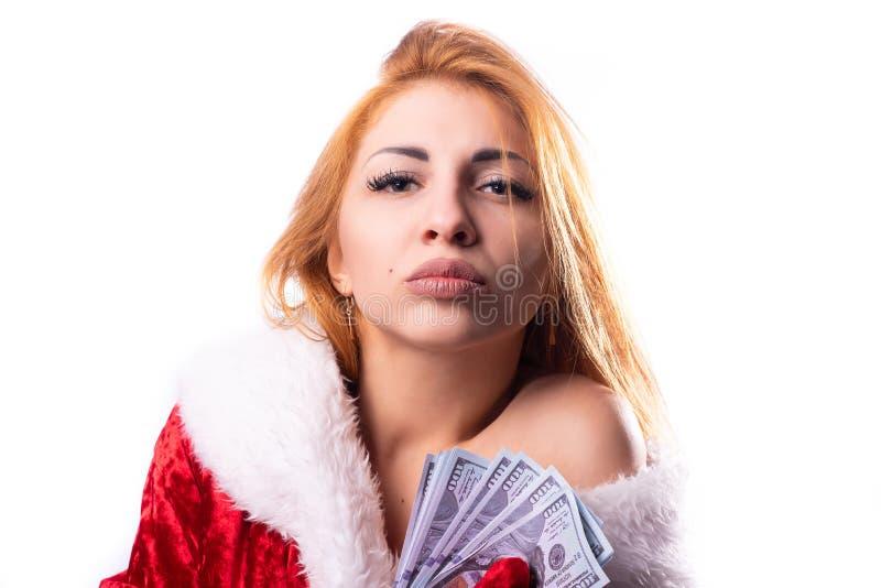 圣诞老人服装的美丽的女孩  免版税库存图片