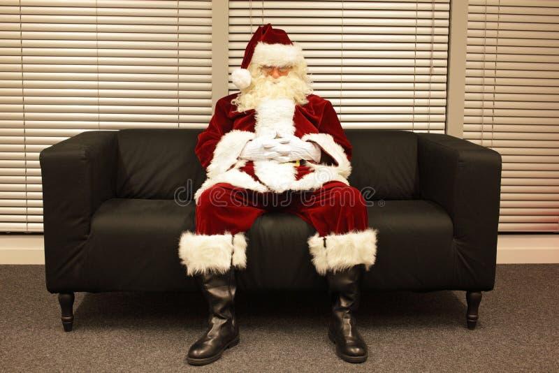 圣诞老人等待的圣诞节工作 免版税库存图片