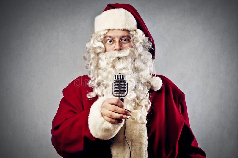 圣诞老人话筒 免版税库存照片