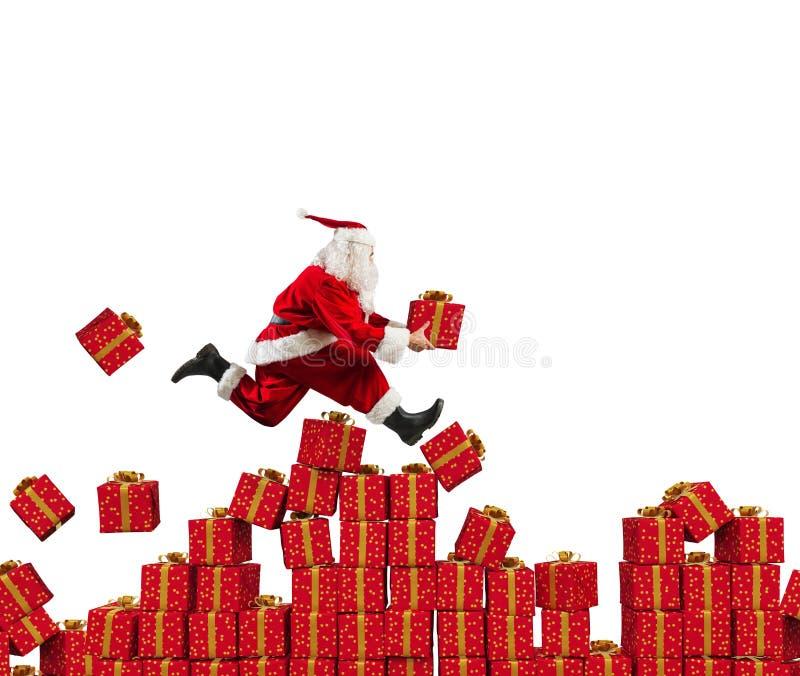 圣诞老人项目快速地去在圣诞礼物 库存照片
