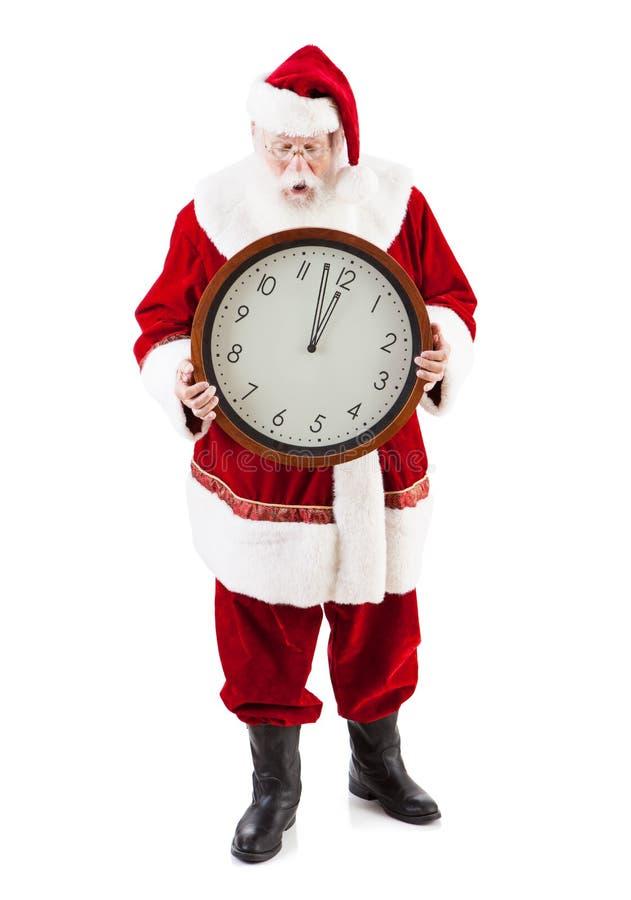 圣诞老人项目担心是晚为圣诞节 免版税库存照片