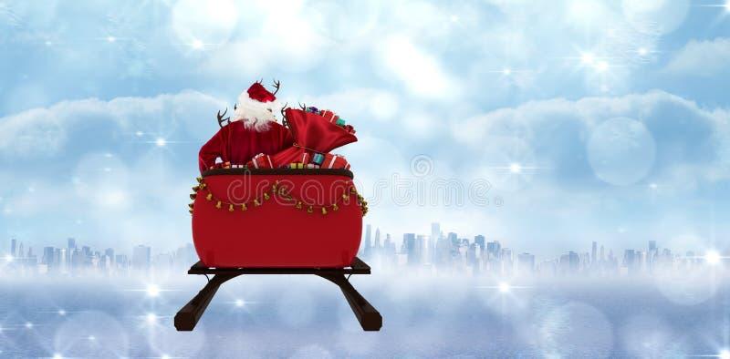 圣诞老人骑马背面图的综合图象在雪撬的有礼物盒的 免版税库存图片
