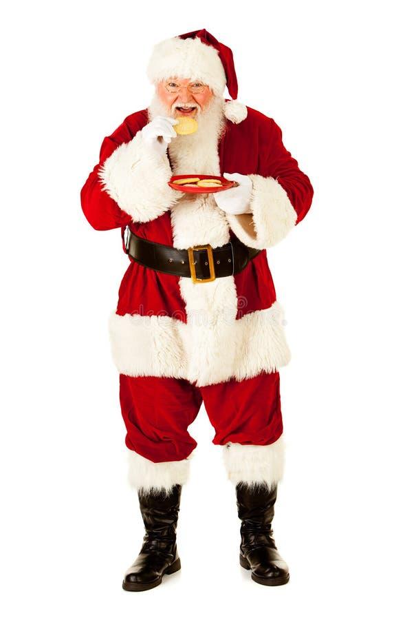 圣诞老人:吃曲奇饼快餐 免版税库存图片