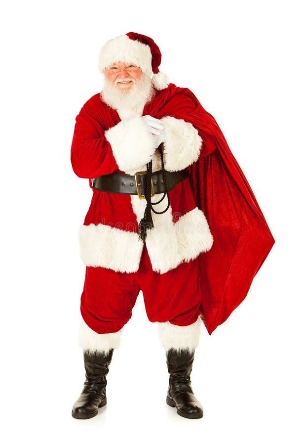 圣诞老人:圣诞老人运载的大袋礼物 图库摄影