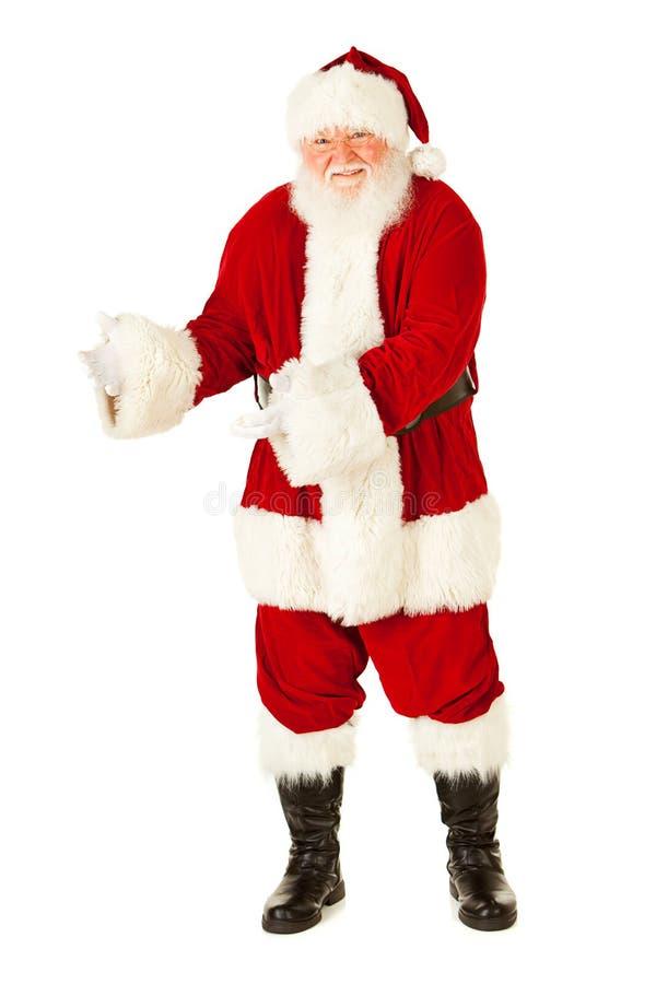 圣诞老人:打手势对边 免版税库存照片