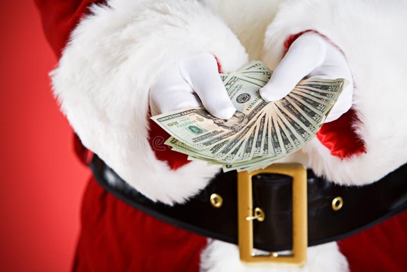 圣诞老人:提供金钱爱好者 免版税图库摄影