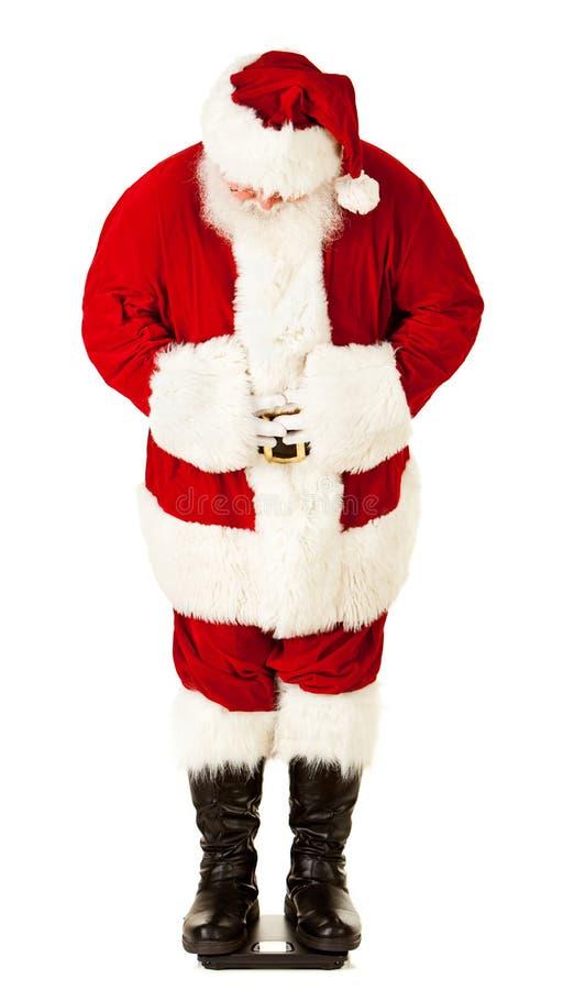 圣诞老人:检查在等级的圣诞老人重量 库存照片