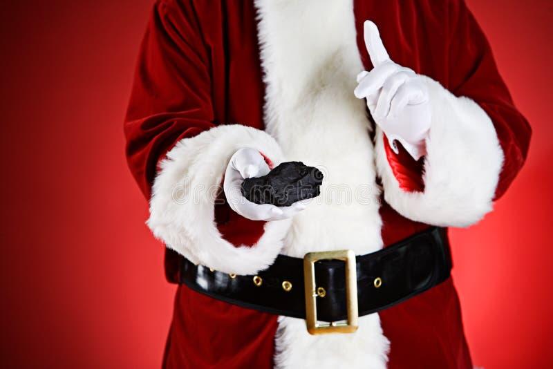 圣诞老人:淘气人民得到圣诞节的煤炭 免版税库存照片