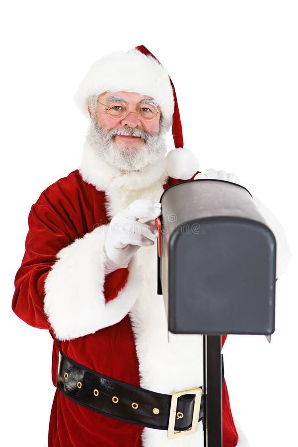 圣诞老人:看在邮箱 库存照片