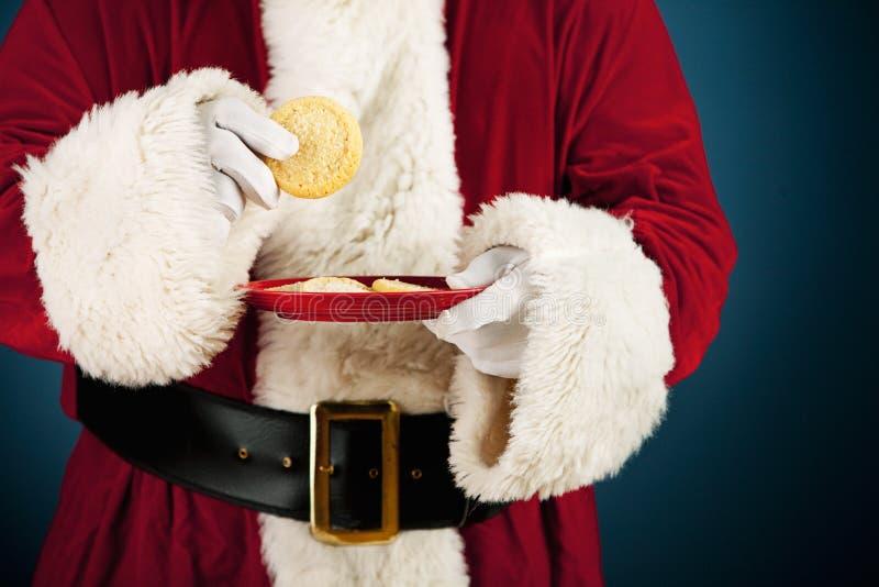 圣诞老人:食用糖屑曲奇饼快餐 库存照片