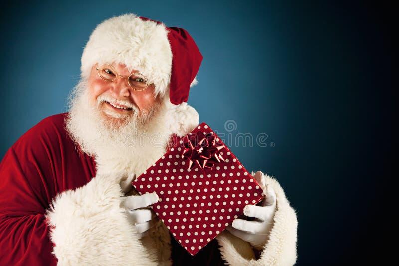 圣诞老人:阻止被包裹的圣诞节礼物 免版税库存图片
