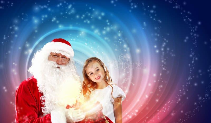 圣诞老人画象有女孩的 图库摄影