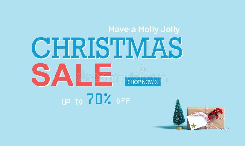 圣诞节与圣诞节礼物盒和树的销售消息 向量例证