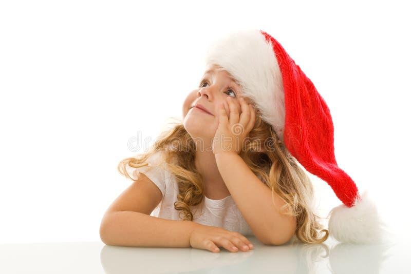 圣诞节作白日梦的女孩少许 库存图片