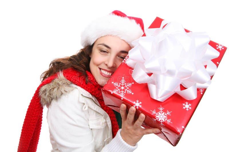 圣诞节俏丽的妇女 免版税库存照片