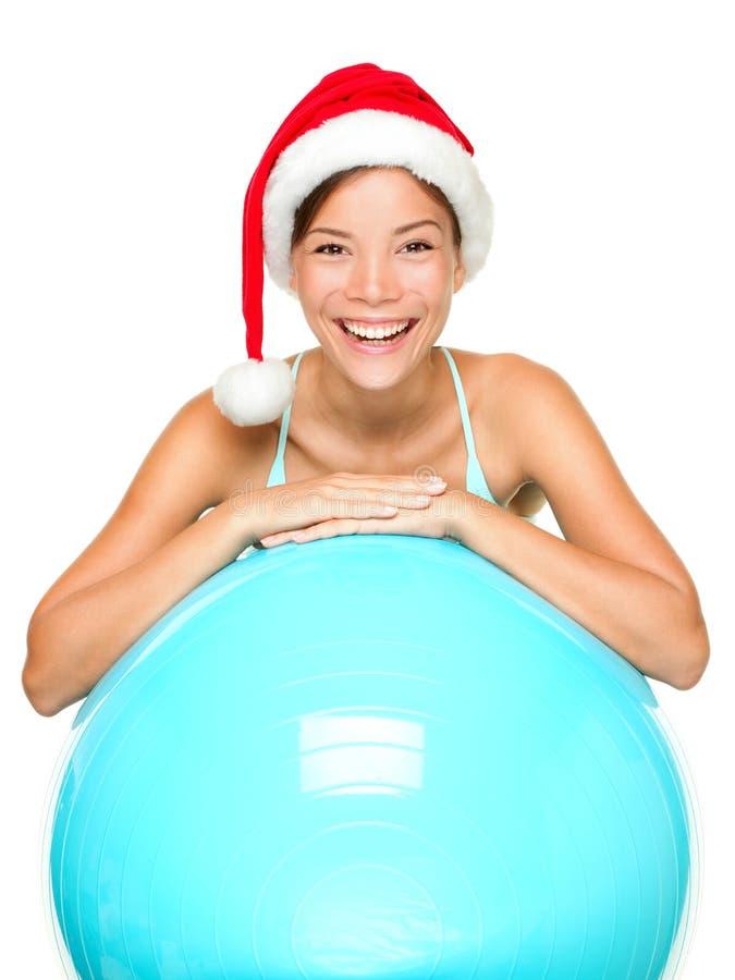 圣诞节健身帽子圣诞老人妇女 免版税库存照片