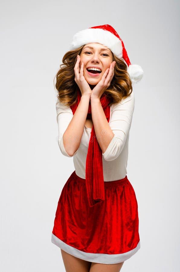 圣诞节圣诞老人帽子被隔绝的妇女画象 女孩愉快微笑 免版税库存照片