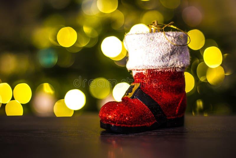 圣诞节圣诞老人起动装饰品 免版税库存图片