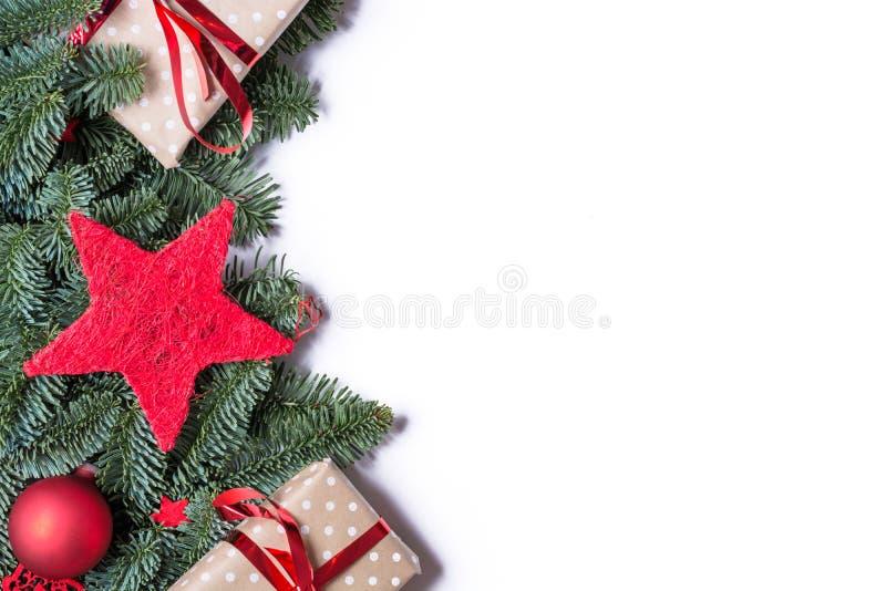 圣诞节在左边的背景边界与冷杉分支a 库存照片