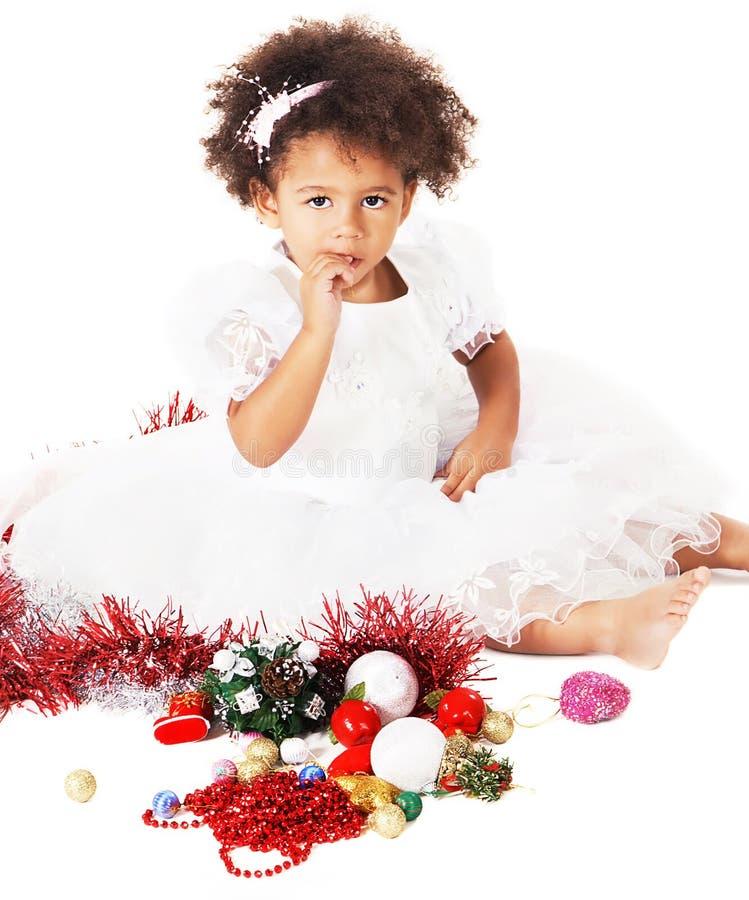 圣诞节女孩小的可爱的使用的玩具 免版税库存图片