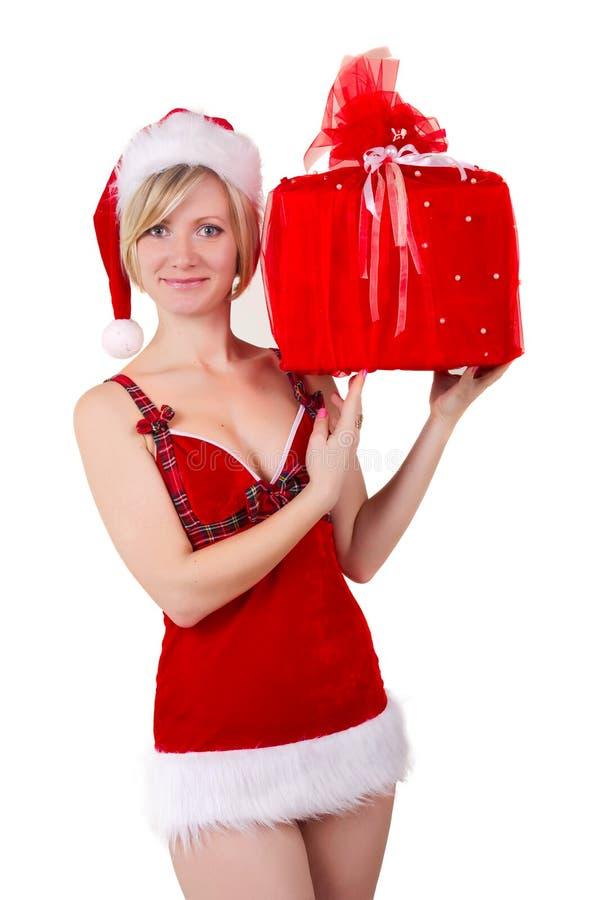 圣诞节女孩诱人与查出的礼品 免版税图库摄影