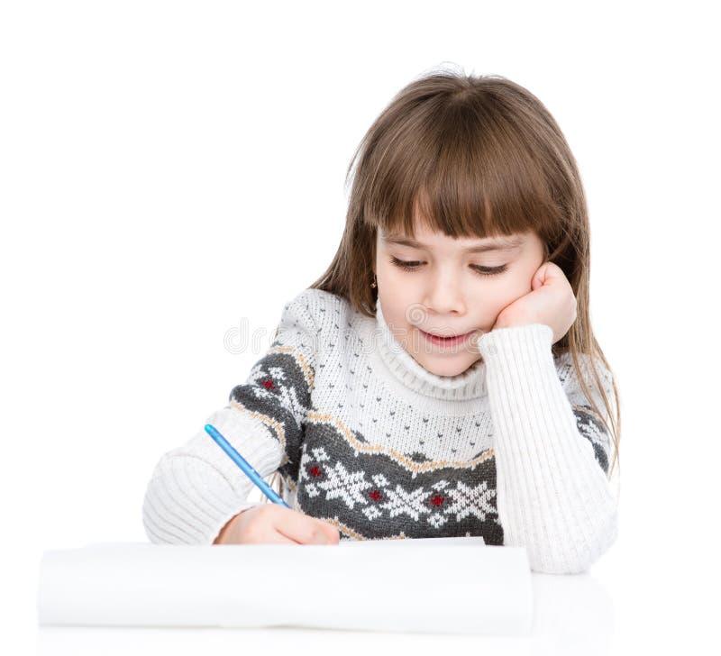 圣诞节女孩给圣诞老人写信 查出在白色 库存图片