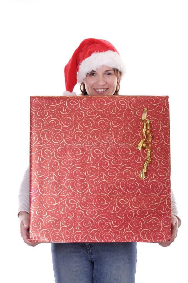 圣诞节帽子存在妇女年轻人 免版税库存图片