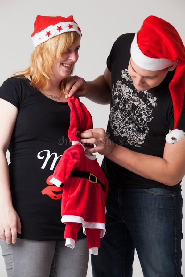 圣诞节怀孕夫妇 库存照片