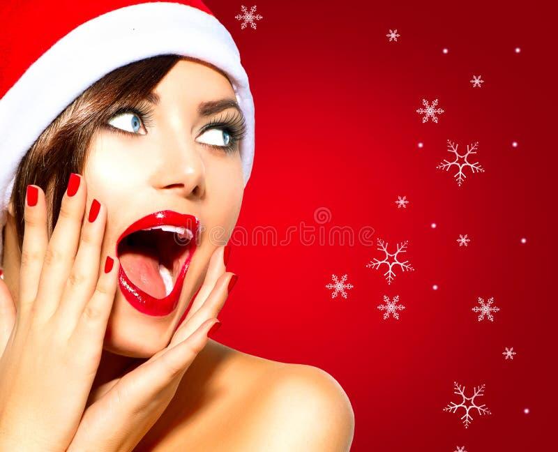圣诞节惊奇的冬天妇女 免版税库存图片