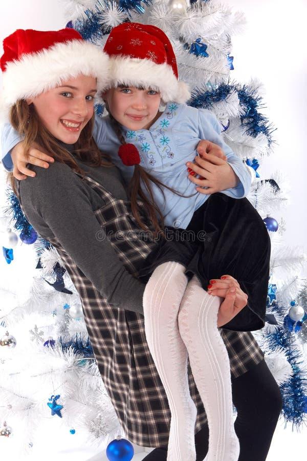 圣诞节愉快的姐妹二 图库摄影