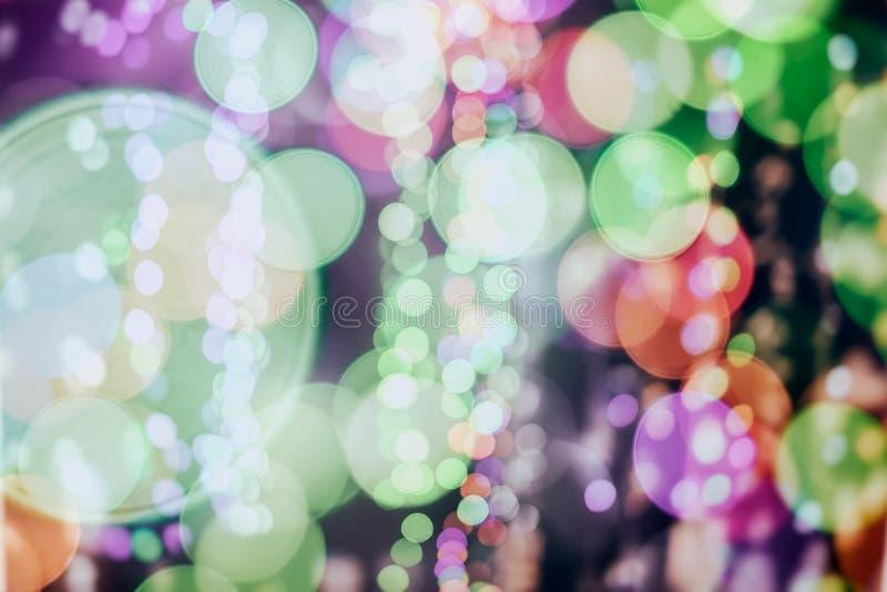 圣诞节抽象背景,明亮的五颜六色的bokeh,发光的欢乐闪烁,设计的,不同的题目 库存照片