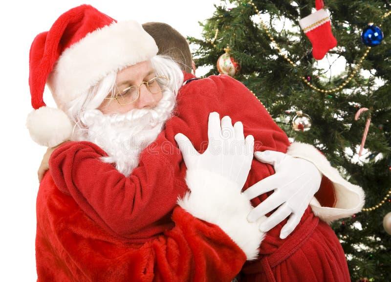 圣诞节拥抱s圣诞老人 库存图片