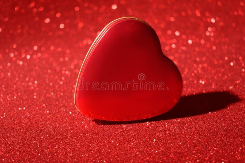 圣诞节新年情人节红色心脏箱子闪烁背景 假日抽象纹理织品 元素,闪光 库存照片