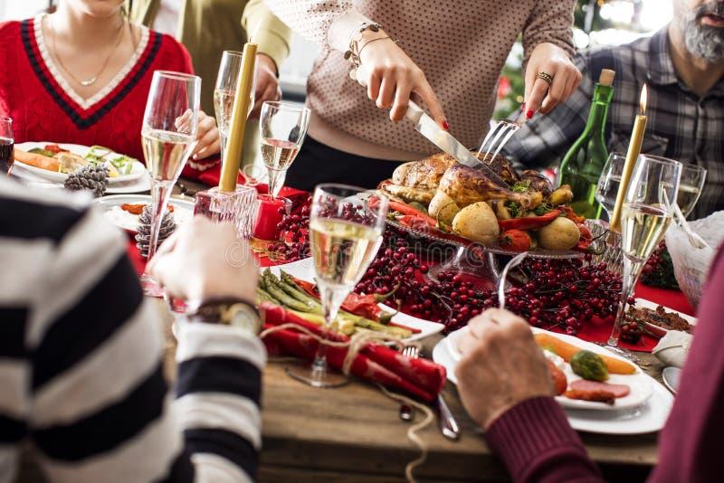 圣诞节新年晚餐小组概念 免版税库存图片