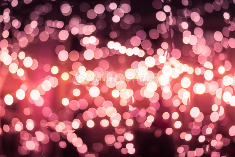 圣诞节新年bokeh背景 被弄脏的轻在温暖的口气背景中 存放商店购物中心概念 模糊软的焦点梦想的城市 库存照片