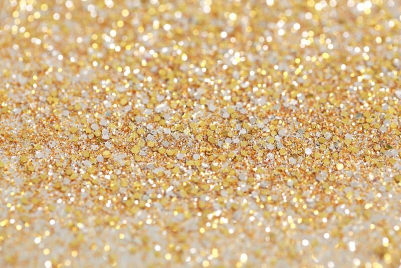 圣诞节新年金子和银闪烁背景 假日抽象纹理