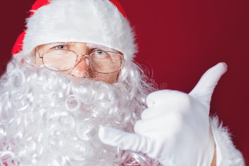 圣诞节时间的凉快和滑稽的圣诞老人 免版税图库摄影