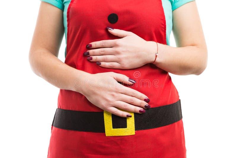 圣诞节暴饮暴食或消化不良胃肠痛苦概念 库存图片
