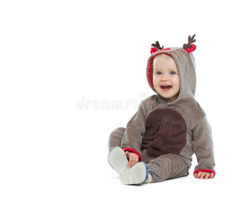 圣诞节服装的微笑的婴孩 图库摄影